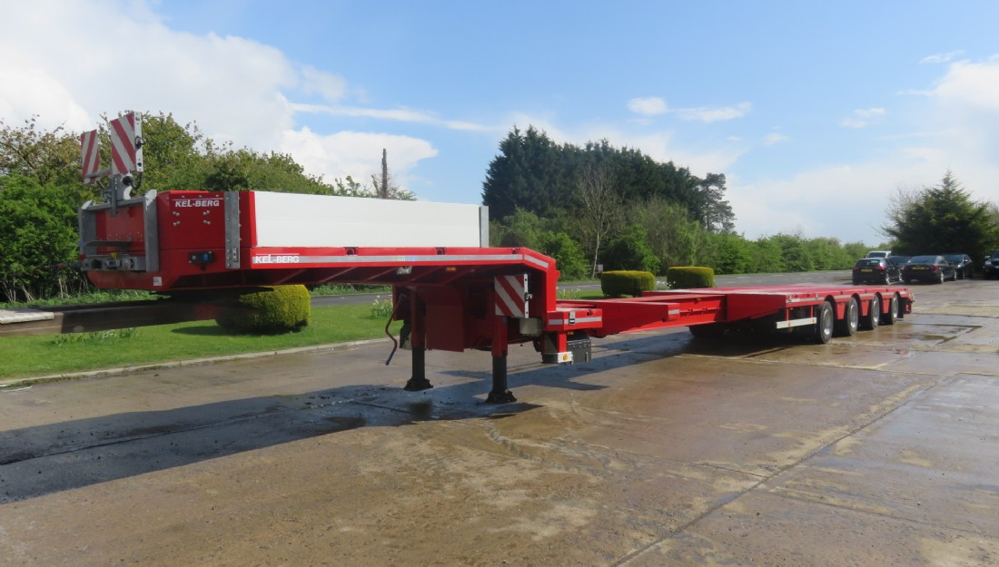 Double extending 4 axle step frame